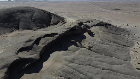 Stunning aerial view on a huge desert with mountains on the horizon, sunny day Live Action