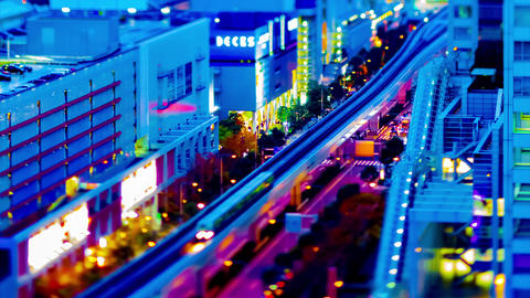 A dusk timelapse of the train on the city railway in Tokyo high angle tiltshift Live Action