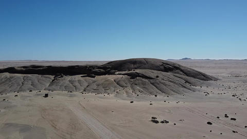 Drone footage of the hills and mountains in the middle of a desert, Namibia Live Action
