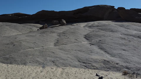 Huge grey rocks in the middle of the desert, stunning aerial view on the terrain Live Action