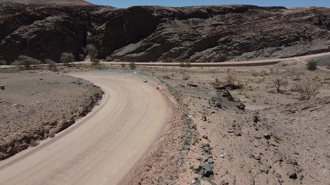 Dusty roads in the dry desert mountain region of Namibia, rocky terrain Live Action