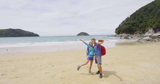 Couple on travel having fun taking phone selfie on Travel in New Zealand Live Action