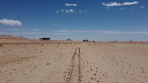 Old railroad and a modern road across the Namib desert, extreme terrain, Africa Live Action