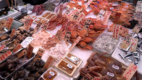 A table with a various seafood at Nishiki market in Kyoto, Japan Live Action
