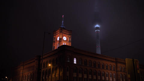 Misteric historic city in fog at night,historic clock tower and television tower Live Action