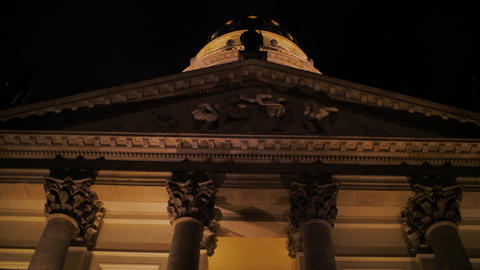 Bottom up of lighted historic building at night Live Action