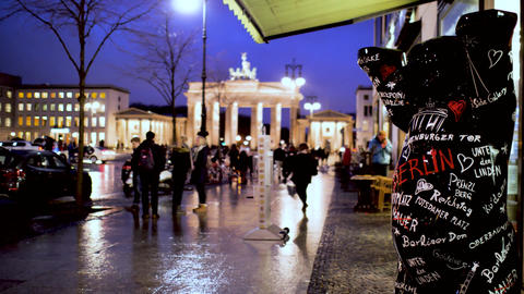 The bear the symbol of Berlin with view of the famous Brandenburg gate Live Action