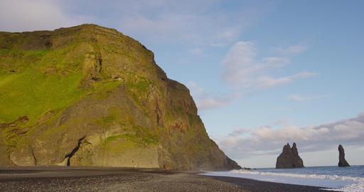 Iceland nature landscape and tourist destination Reynisfjara black sand beach Live Action