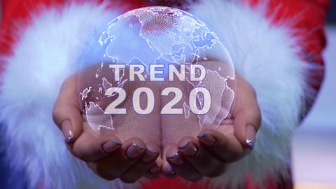 Hands holding planet with text Trend 2020 Live Action