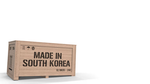 Wooden crate with MADE IN SOUTH KOREA text on white background. South Korean Live Action