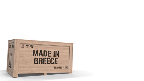 Wooden crate with printed MADE IN GREECE text isolated on light background Live Action