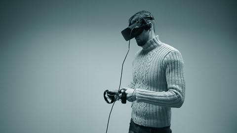Man in a virtual reality helmet. Young male European Caucasian Live Action
