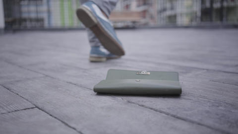 Close-up of wallet falling down from pocket of unrecognizable person Live Action