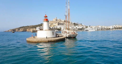 ibiza lighthouse from calm sea at daylight, in summer very popular, sandy coast have a fantastic Live Action