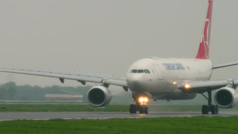 Airfreight slowing after landing at rainy weather Stock Video Footage