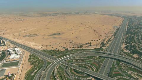 Aerial view of a big highway interchange and desert near Dubai, UAE Live影片