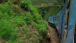 Train crossing amazing highlands forest landscape with tunnels. Sri Lanka Footage