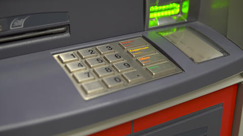 ATM close-up. ATM for cash withdrawal and deposit. The card entry slot blinks Live Action