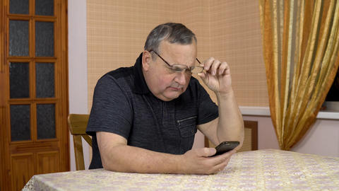A man uses a telephone for the first time. The old man hardly dialed the number Live Action