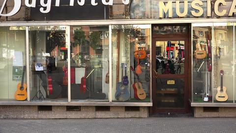 Shop musical instruments in Barcelona. Spain. 4K GIF