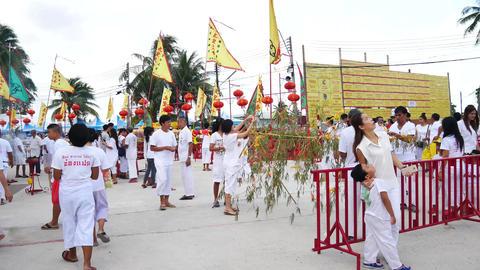PHUKET, THAILAND October - 1 : phuket vegetarian festival people gilding on The Footage