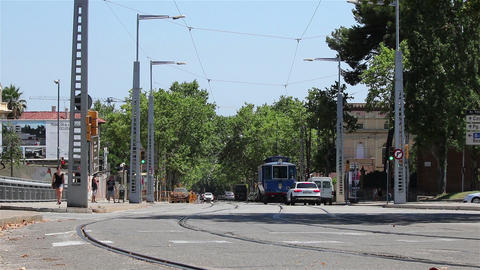 Street with a blue tram Footage