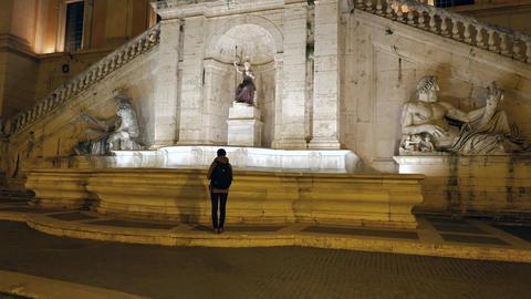 Girl is coming to Fontana della Dea Roma. Night. Rome, Italy Footage