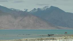 Indian tourists on causeway on Lake,Pangong,Ladakh,India Footage