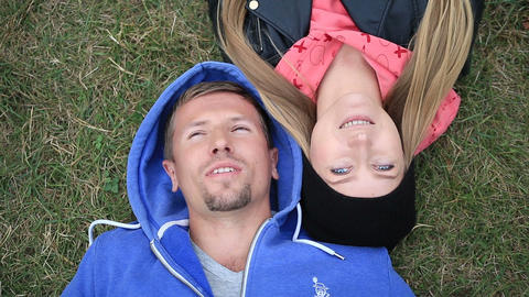Sweethearts students lying on grass head to head Footage