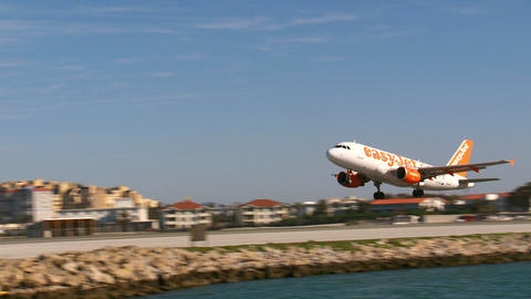 easy jet plane takes off from Gibraltar airport runway Live Action