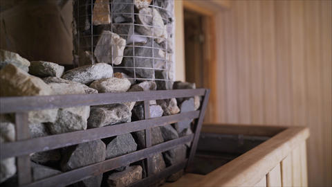 Close-up of natural gray rough stone for sauna. Can be used as a background Live Action