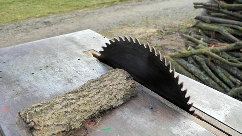 Stop sawmill blade. Finnish cutting of wood log on steel board. Blade is blurred from motion and Live Action
