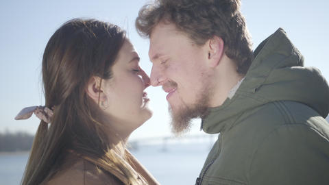 Close-up of smiling Caucasian man with nose ring and chubby brunette woman Live Action
