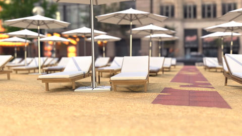 Wooden beach chairs and umbrellas near the hotel Animation