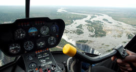 View from the helicopter on the Victoria Falls, dashboard of the helicopter, 4k Live Action
