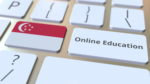 Online Education text and flag of Singapore on the buttons on the computer Live Action