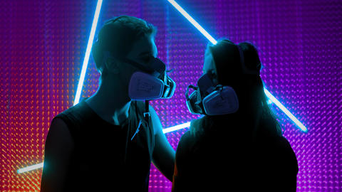 Young couple in the neon lights of the club. Concept of dubstep or punk style Live Action