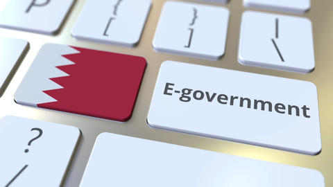 E-government or Electronic Government text and flag of Bahrain on the keyboard Live Action
