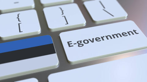 E-government or Electronic Government text and flag of Estonia on the keyboard Live Action
