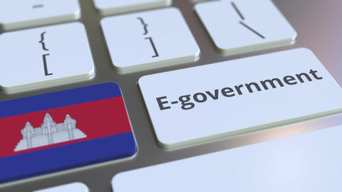 E-government or Electronic Government text and flag of Cambodia on the keyboard Live Action