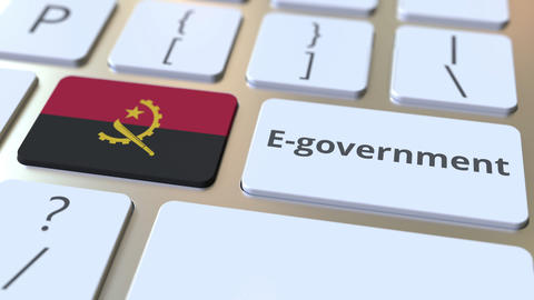 E-government or Electronic Government text and flag of Angola on the keyboard Live Action