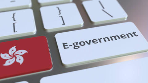 E-government or Electronic Government text and flag of Hong Kong on the keyboard Live Action