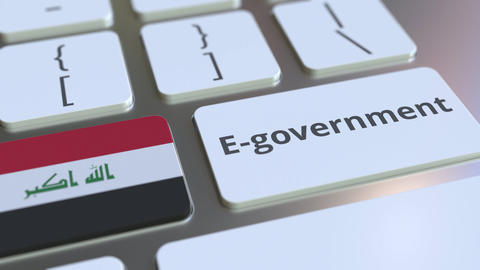 E-government or Electronic Government text and flag of Iraq on the keyboard Live Action