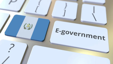 E-government or Electronic Government text and flag of Guatemala on the keyboard Live Action