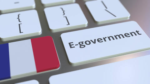 E-government or Electronic Government text and flag of France on the keyboard Live Action