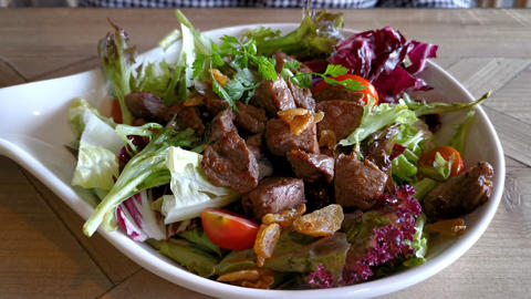 Tasty salad with grilled beef steak Live Action