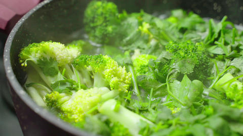 Cooking Broccoli Soup. bubbling broth of green vegetable…, Live Action