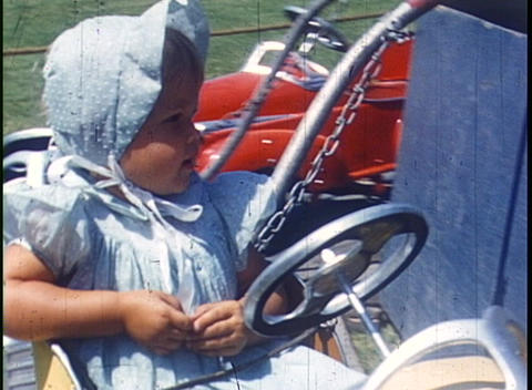 Children ride rides in an amusement park in this home movie Stock Video Footage