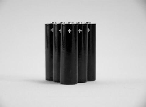 A cluster of small batteries with plus signs Stock Video Footage