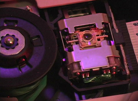 Close up of the interior workings of a CD-room drive Stock Video Footage